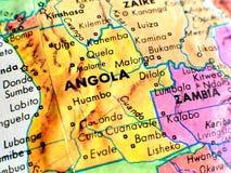 Съемка макроса фокуса Анголы Африки на карте глобуса для блогов перемещения, социальных средств массовой информации, знамен вебса Стоковые Изображения RF