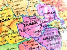 Съемка макроса фокуса Африки Замбии на карте глобуса для блогов перемещения, социальных средств массовой информации, знамен вебса Стоковые Изображения RF