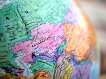 Съемка макроса фокуса Казахстана на карте глобуса для блогов перемещения, социальных средств массовой информации, знамен вебсайта Стоковые Фотографии RF