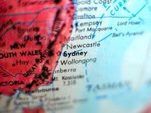 Съемка макроса фокуса Сиднея Австралии на карте глобуса для блогов перемещения, социальных средств массовой информации, знамен ве Стоковое Фото