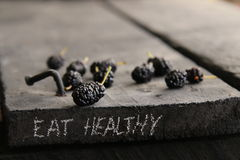 Съешьте здоровую надпись Диета, вытрезвитель, чистая еда или вегетарианская концепция Стоковые Изображения