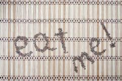 Съешьте меня слова написанные с чечевицами Стоковое Изображение RF