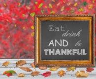 Съешьте питье и благодарная написанная внутренняя картинная рамка стоковая фотография rf