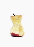 Съеденное яблоко изолированное на белой предпосылке стоковые изображения