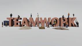 Сыгранность слова и работники которая работают на ей стоковое фото