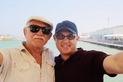 Сынок и отец стоковое фото