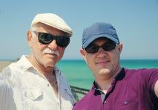 Сынок и отец стоковое фото rf