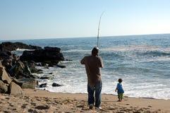 сынок рыболовства отца Стоковое фото RF