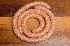 сырцовое закрученное в спираль пряное сосисок Стоковая Фотография RF