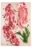 Сырцовое мясо свинины на вырезывании Стоковое Изображение