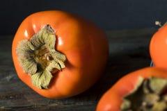 Сырцовое органическое оранжевое Perssimons Стоковое Фото