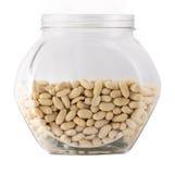Сырцовые арахисы в стеклянном весе тары Стоковая Фотография RF
