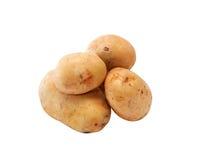 Сырцовые картошки на белизне Стоковое фото RF