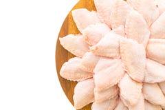 Сырцовые мясо и крыло цыпленка на деревянных разделочной доске или плите Стоковое фото RF