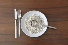 Сырцовые фасоли в блюде Стоковое Изображение