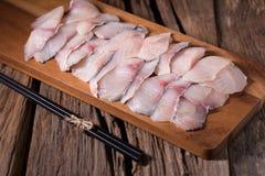 Сырцовые филе белых рыб на предпосылке деревянной доски Стоковое фото RF