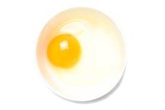 Сырцовые яичка в белом шаре на белой предпосылке Стоковое Изображение