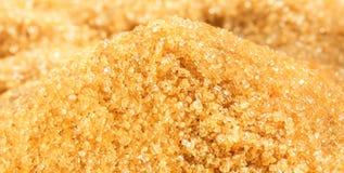 Сырцовый конец кучи желтого сахарного песка вверх по съемке Стоковые Изображения RF