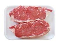 Сырцовый стейк говядины в пластмассе или подносе пены Стоковое Фото