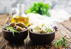 Сыр и оливки стоковые изображения