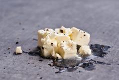 Сыр фета на черной доске Стоковое Изображение