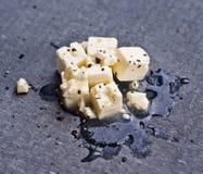 Сыр фета на черной доске Стоковая Фотография
