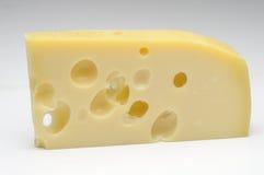 Сыр Эмменталя на белой предпосылке Стоковая Фотография RF