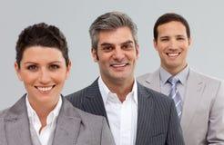 Сь бизнесмены стоя совместно Стоковое Изображение RF