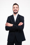 Сь бизнесмен стоя при сложенные рукоятки Стоковое фото RF