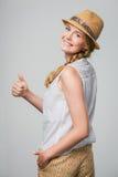 Сь женщина gesturing большой пец руки вверх Стоковое Фото