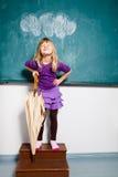 Сь маленькая девочка с зонтиком внутри помещения Стоковая Фотография