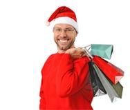 Сь человек рождества нося шлем santa Стоковые Фото