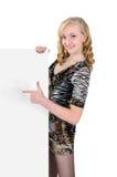 Сь девушка держа пустой плакат изолировано на белизне Стоковая Фотография RF