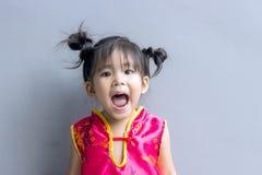 сюита азиатской девушки китайская в красном цвете Стоковая Фотография RF