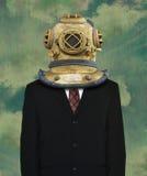 Сюрреалистический деловой костюм, водолазный шлем Стоковые Фото