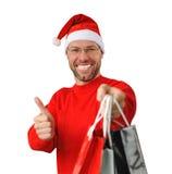 Ся человек рождества нося шлем santa Стоковая Фотография RF