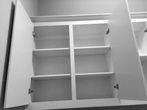 Славный кухонный шкаф в предпосылке нового дома стоковые фото