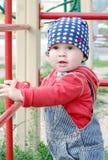 Славный младенец на спортивной площадке стоковые фото