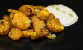 Сладкие картофели и соус лука Стоковые Изображения RF