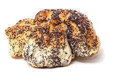 Сладостные плюшки с маковыми семененами на белой предпосылке Стоковая Фотография