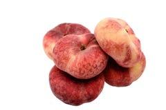 Сладостные сладостные плоские персики изолированные на белой предпосылке Стоковое фото RF