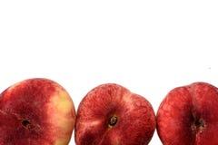 Сладостные сладостные плоские персики изолированные на белой предпосылке Стоковые Изображения