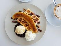 Сладостные waffle и банан Стоковая Фотография RF
