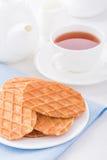 Сладостные waffles на белой плите Стоковое Изображение