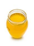 Сладостный мед в стеклянном опарнике на белой предпосылке Стоковые Фотографии RF