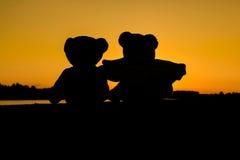 Сладостный сидеть плюшевого медвежонка влюбленности Стоковые Фото