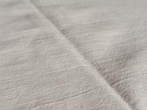 С белой предпосылки текстуры ткани Стоковое Изображение