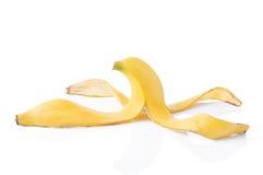 Слезли кожа банана на белой предпосылке Стоковое Изображение