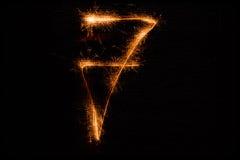 7 сделал бенгальских огней на черноте Стоковое Изображение