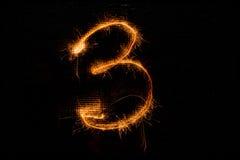 3 сделал бенгальских огней на черноте Стоковая Фотография